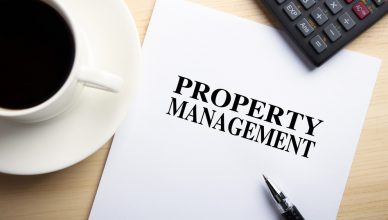 Text Property Management is on the white paper with coffee, calculator and ball pen aside.